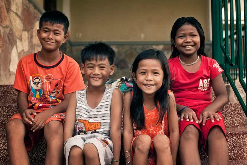 4 sponsored children smiling in Battambang, Cambodia