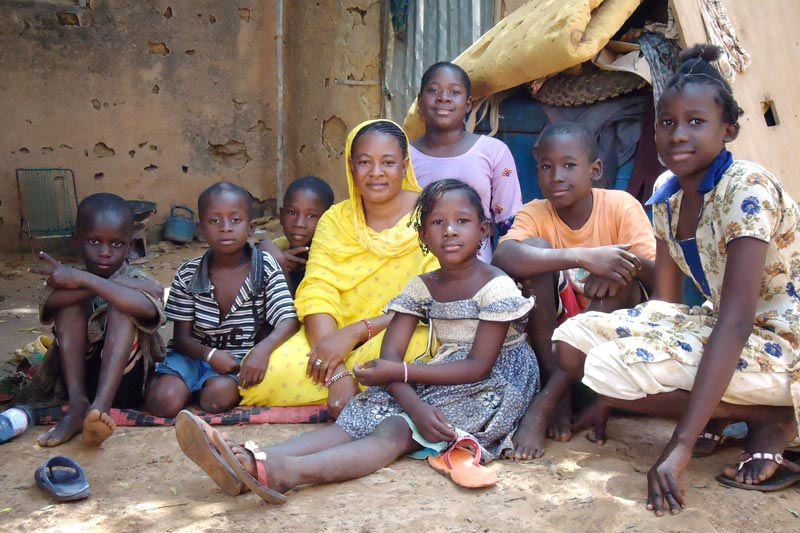 Family sitting on the ground in Mali