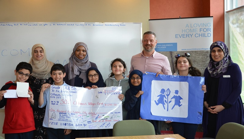 Abraar Elementary with SOS President Thomas Bauer