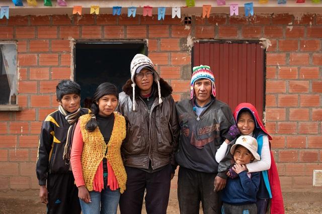 Secundino standing with his children.