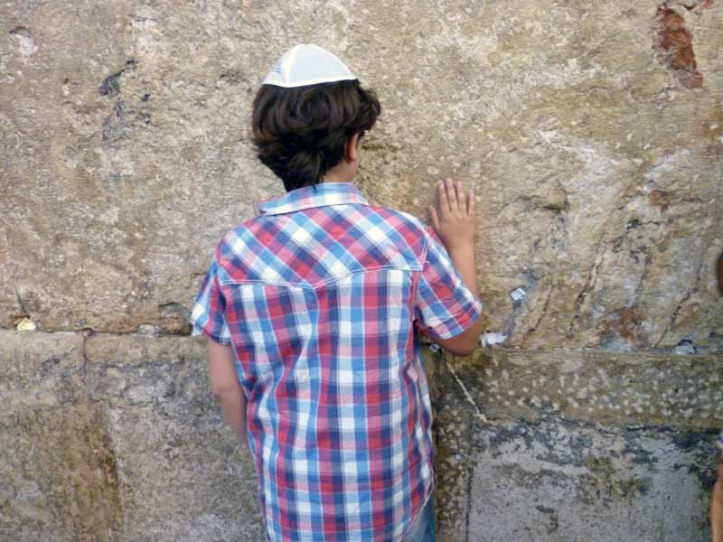 Sponsored boy in Israel praying at the Western Wall in Jerusalem, Israel