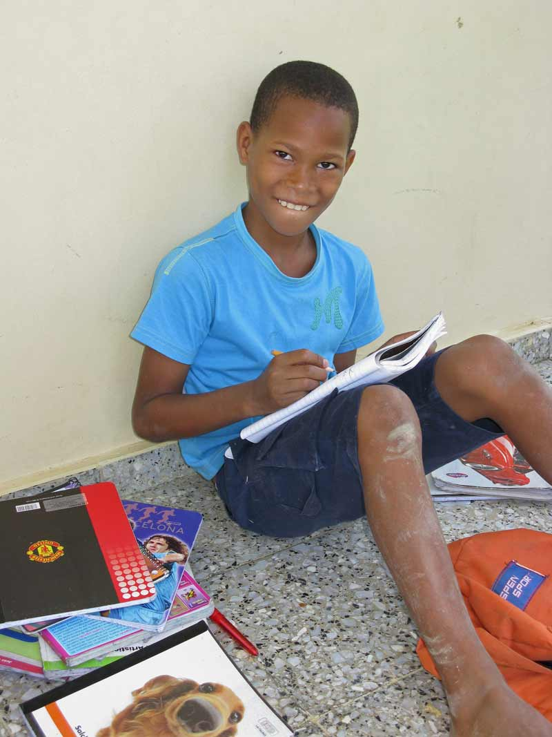 Sponsored child doing homework