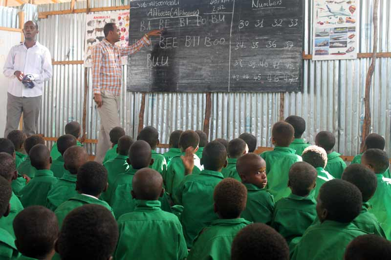 Boys in classroom in Somalia - Sponsor a child today