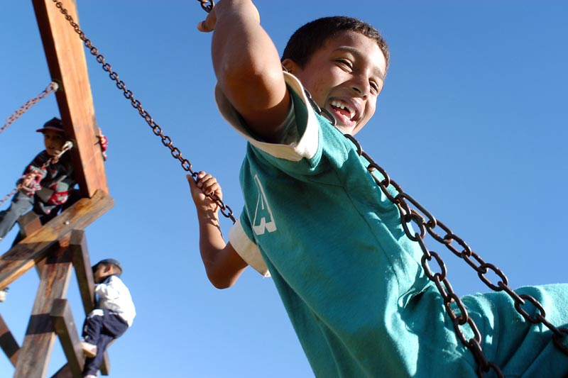 Children on play structure - Sponsor a child in Morocco