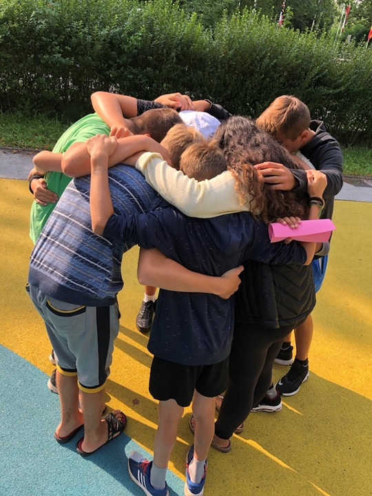 SOS kids hugging goodbye on the last day of camp.