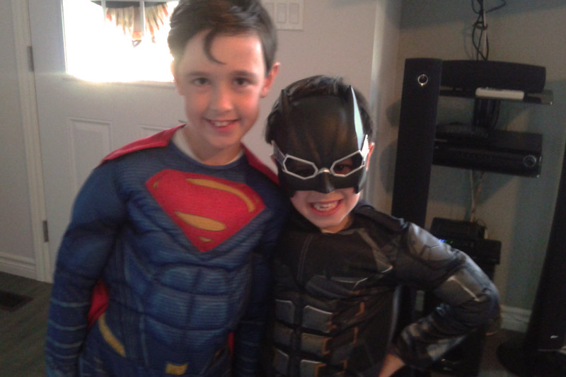 Two young boys in their superhero costumes
