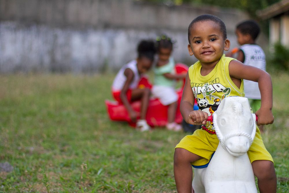 Sponsored boy on toy horse in Brazil