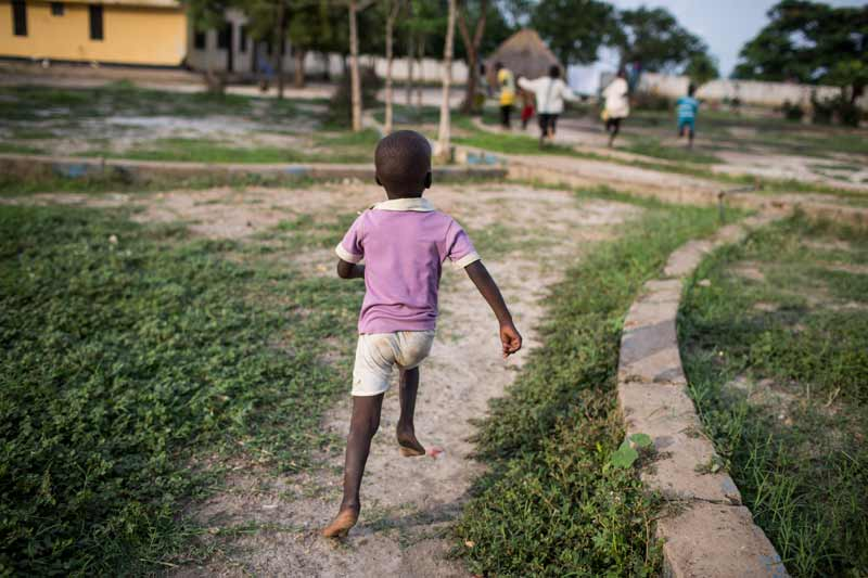 Boy running in South Sudan - Sponsor a Child in South Sudan