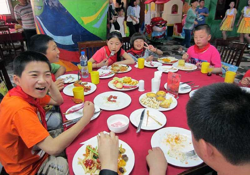 Children having a meal in Yantai, China