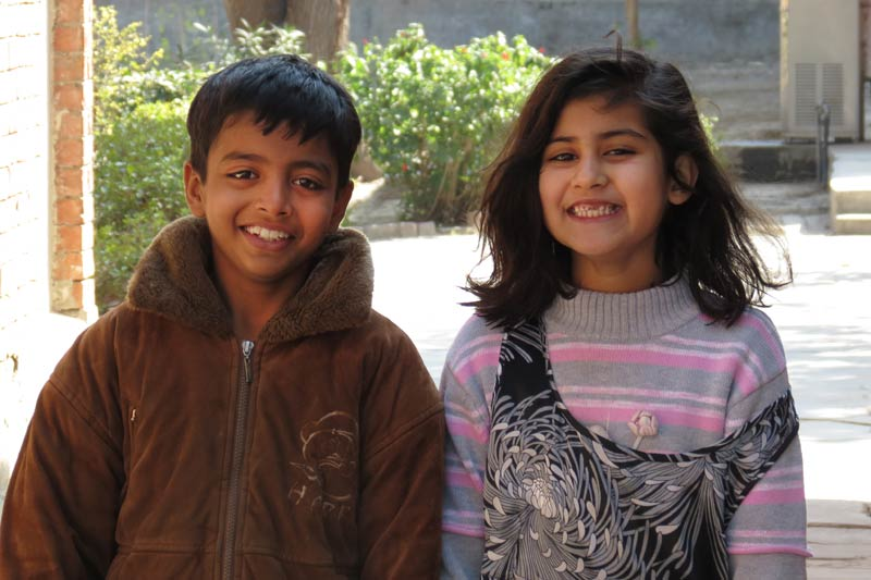 Two children smiling in Pakistan