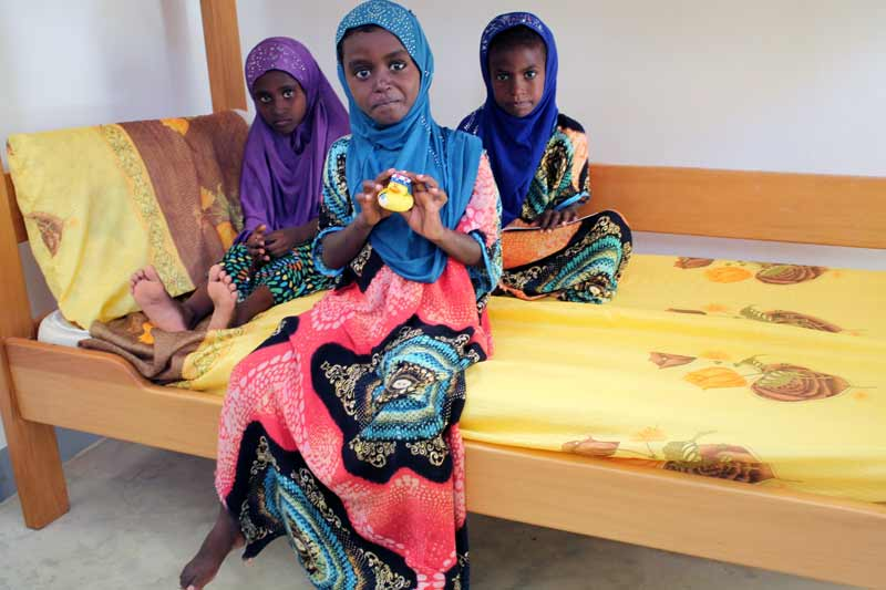 Sponsored children sitting on bed in Djibouti