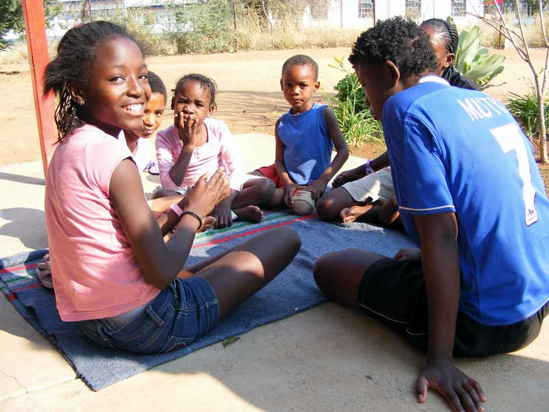 Children playing cards in Tsumeb, Namibia