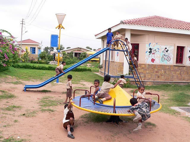 Kindergarteners playing on play structure