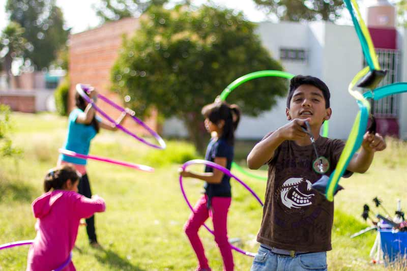 Children playing with hoops with SOS Social Circus in Mexico