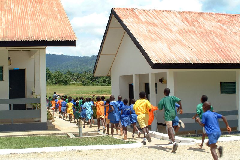Children running between houses at the SOS Children's Village in Asiakwa, Ghana