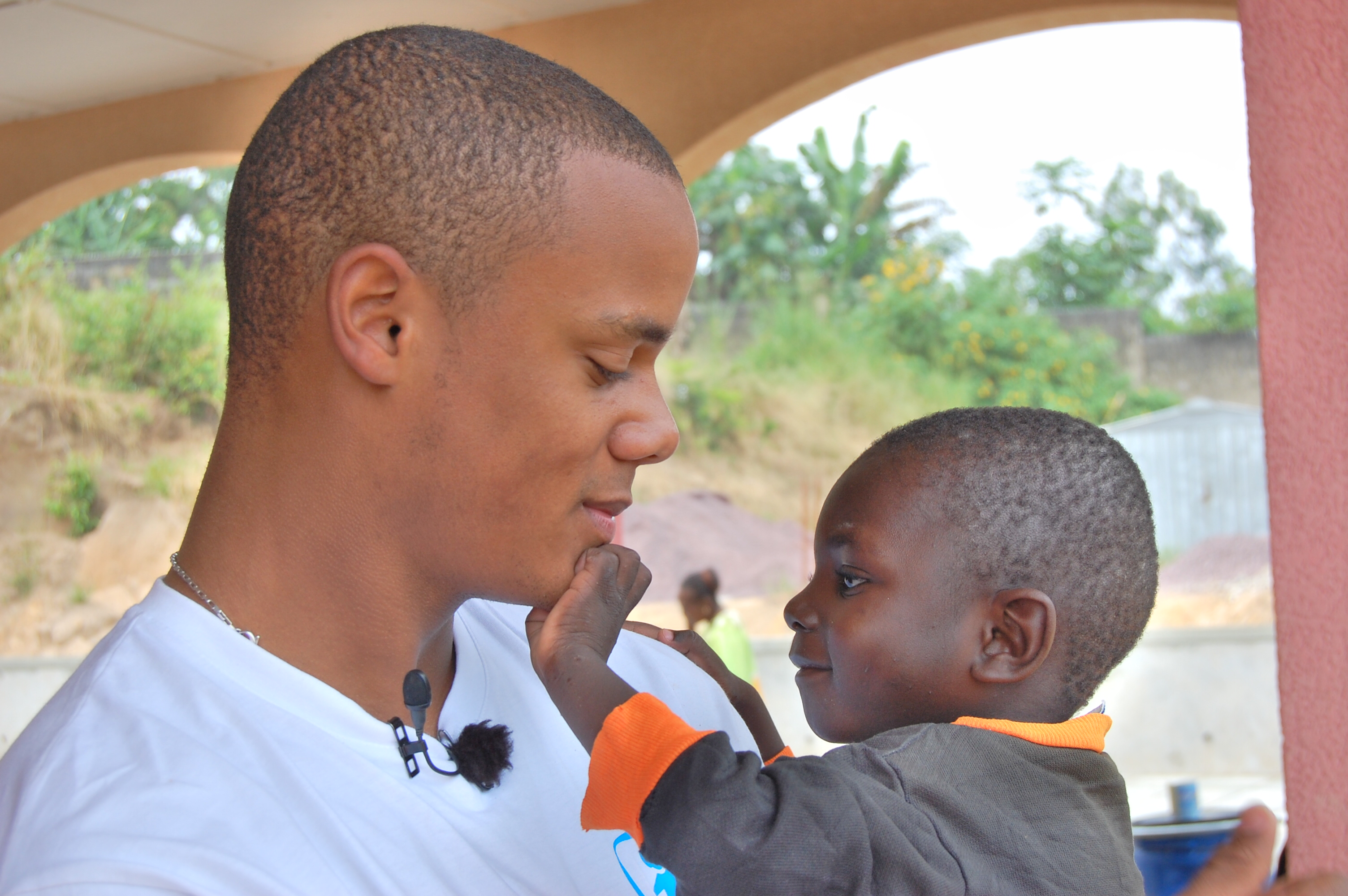 Vincent Kompany with an SOS child