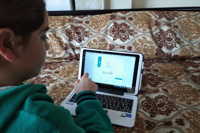 An SOS child does her school work online during the COVID-19 crisis.