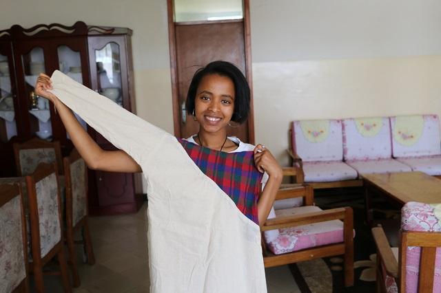 Derartu showing off one of her fashion designs.