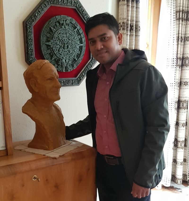Dr. Arif posing with statue