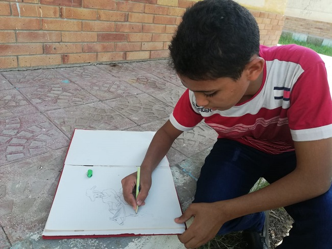 Samer working on another drawing.