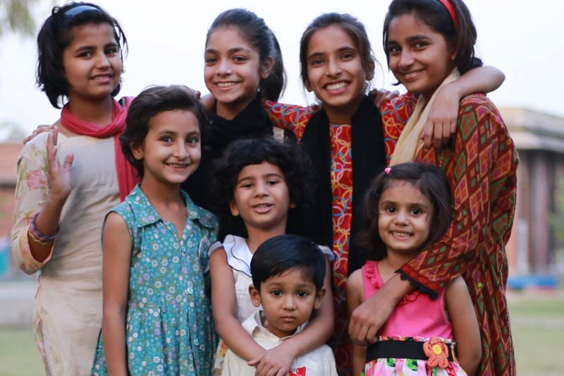 Eight Pakistani children smiling