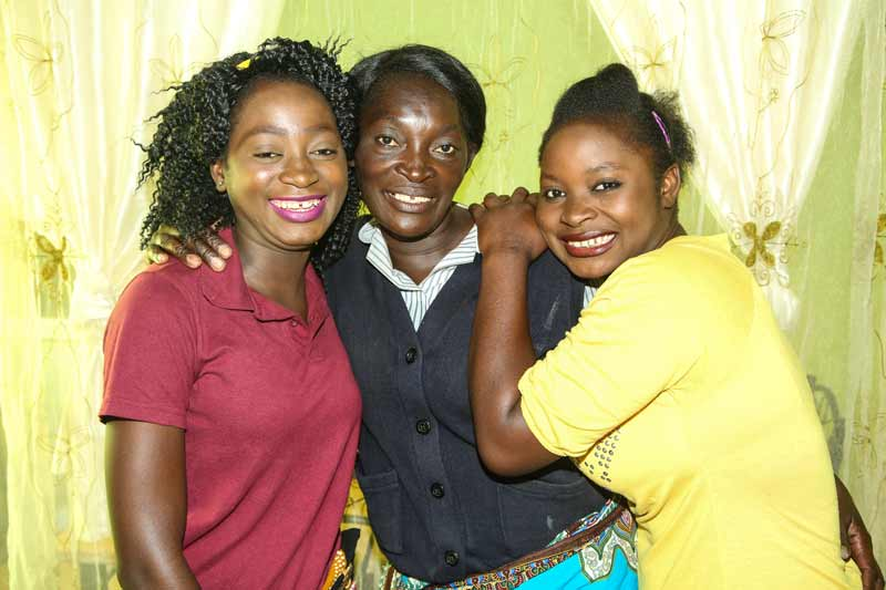 Esther with her two daughters in Kitwe, Zambia