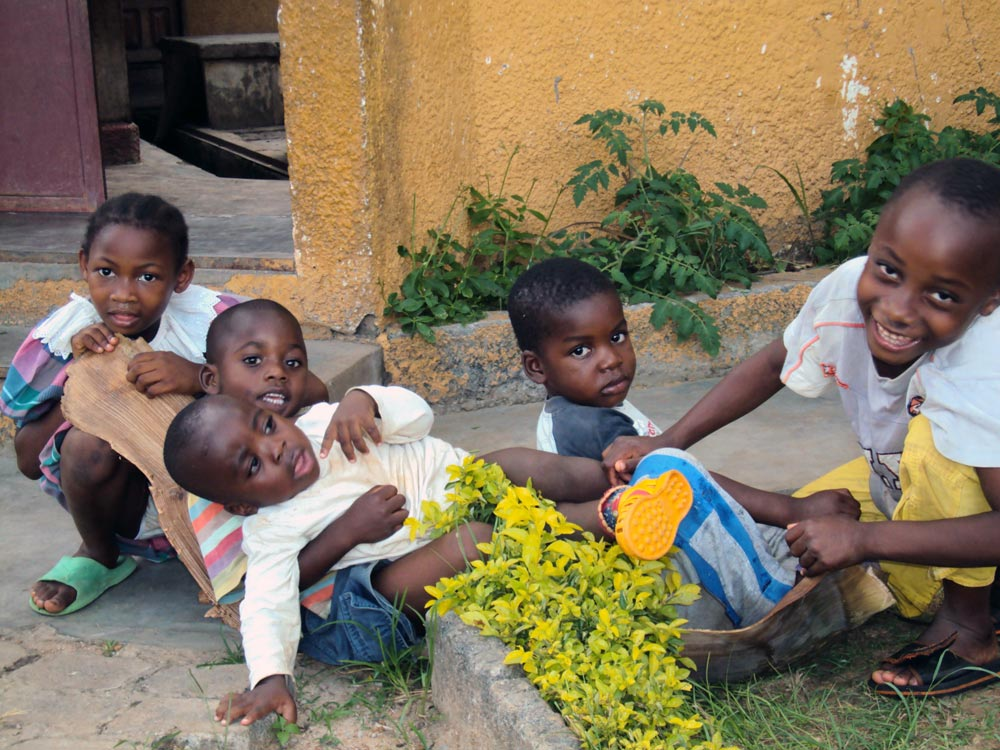 Five SOS children playing outside