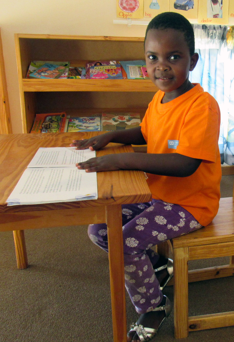 S'piwe* sitting at her desk in the SOS Village in Nhlangano, Swaziland