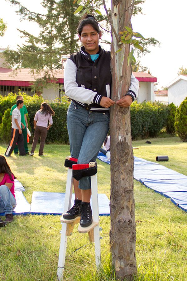 After overcoming her fears, Melissa stands tall on her stilts amid an SOS Social