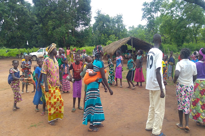 Villagers standing in line for assistance.