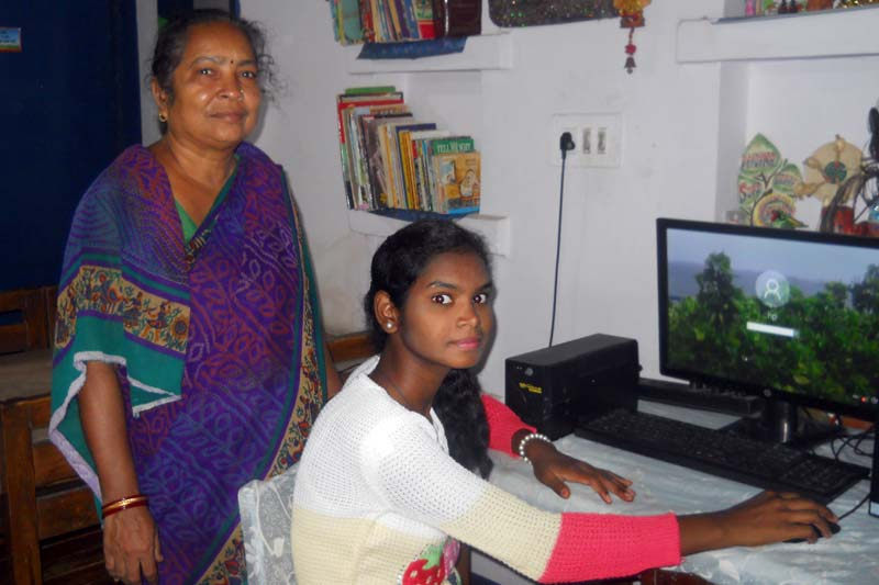 Girl on computer in India