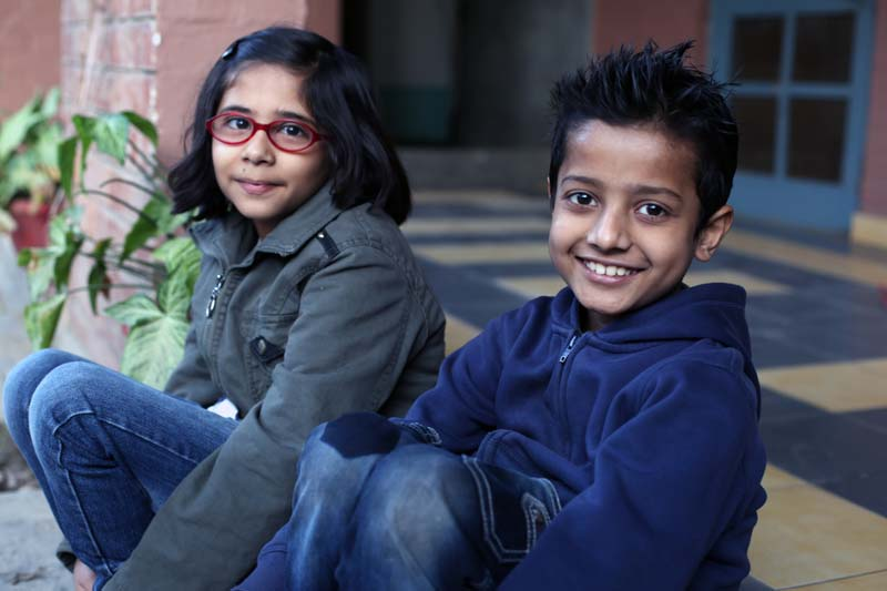 Girl and boy smiling in Pakistan