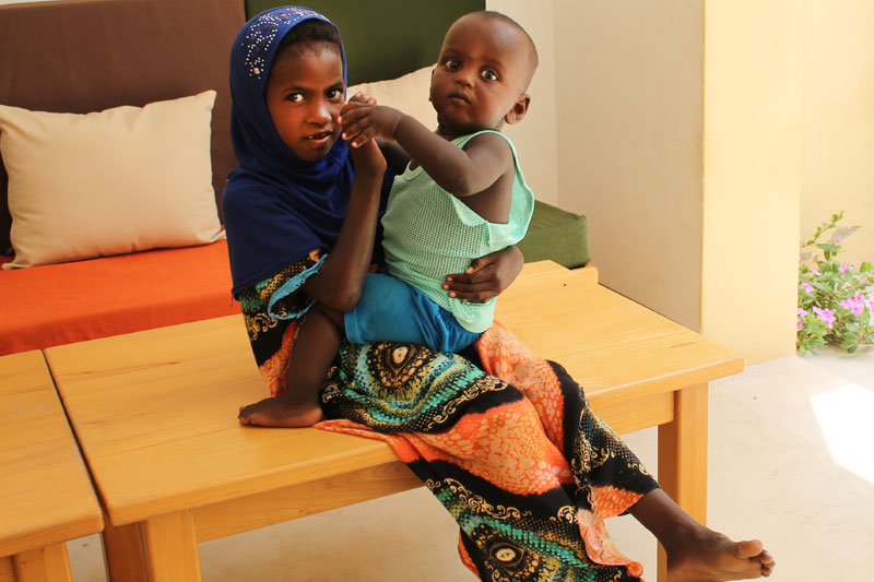 Rara holding her SOS brother in - Tadjourah, Djibouti
