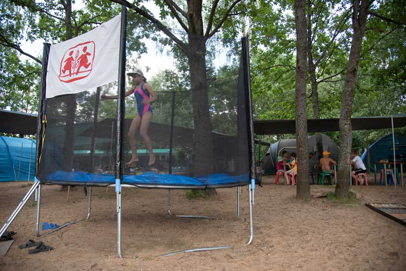 Girl on trampoline at summer camp in Belarus