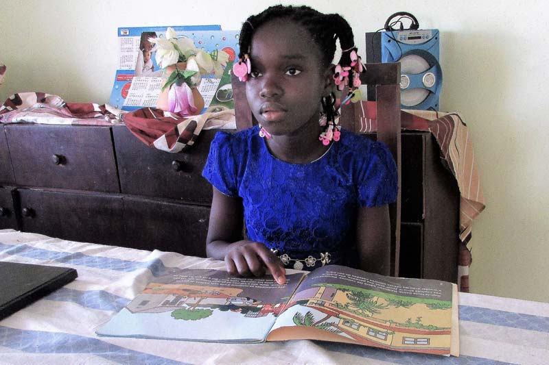 SOS child working on her homework in Côte d'Ivoire