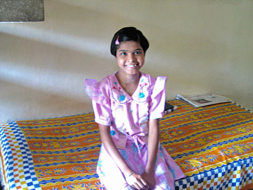 Girl smiling at the SOS Children's Village in Faridabad, India