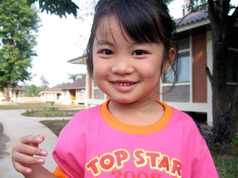 Smiling sponsored girl in Laos