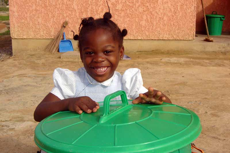 Sponsored girl smiling in the playground in Cameroon