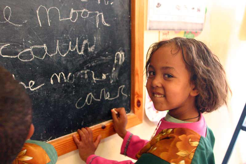 Sponsored child writing on chaulk board in Ethiopia