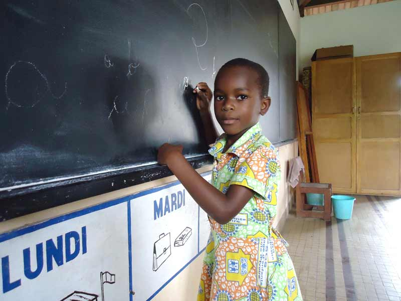 Sponsored girl writing on blackboard in Côte d'Ivoire