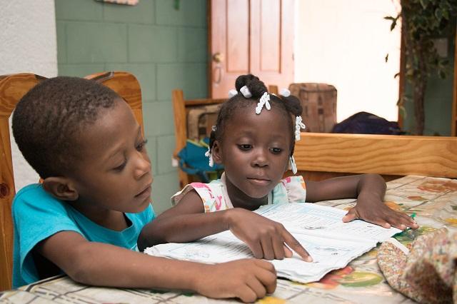 SOS Haiti children doing their homework.