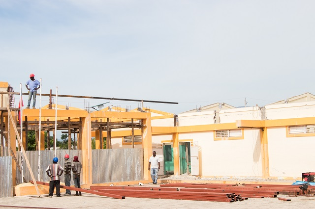 SOS members and volunteers beginning the rebuilding process.