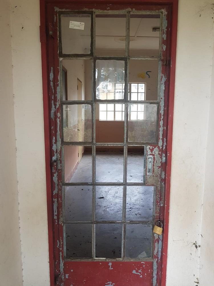Broken glass on door