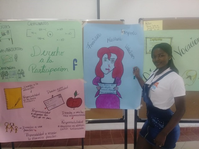 Luna showing off some work in the classroom.