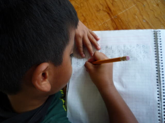 An SOS child working on his studies.