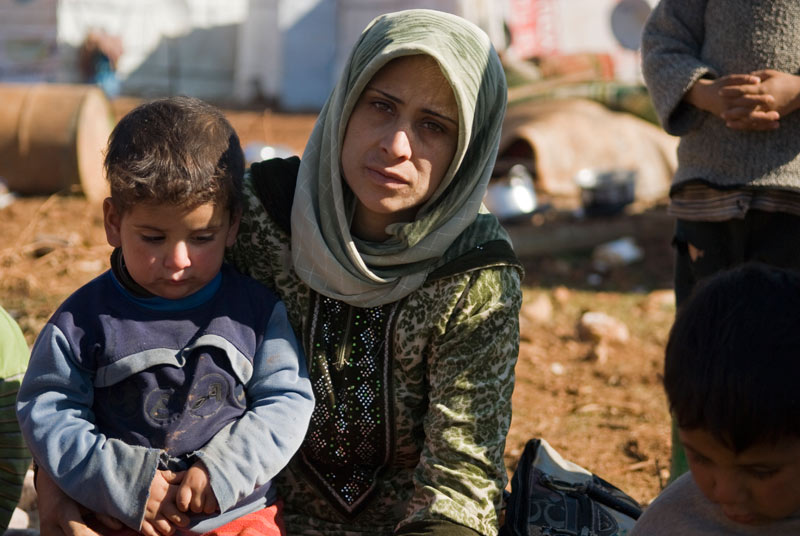Syrian mother and son in refugee camp in Lebanon