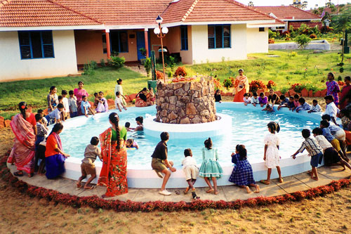Mothers and children in village pool in Visakhapatnam, India