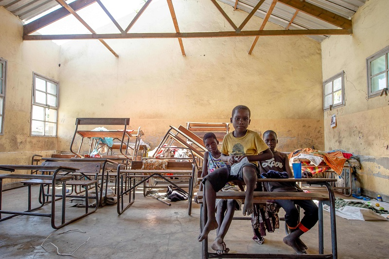 Children shelter in damaged school