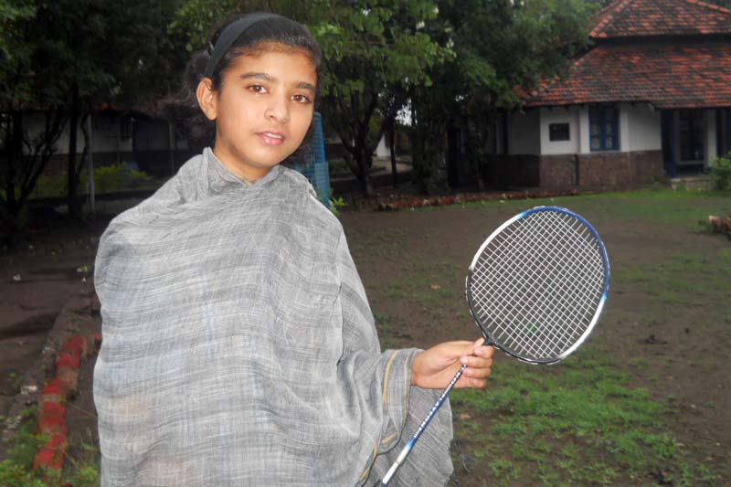 Girl with badminton racket