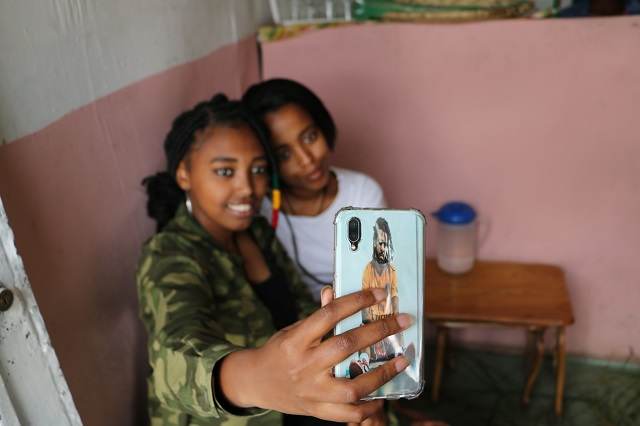Fayo and a friend posing for a selfie.
